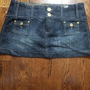 YNQ 7 mini denim skirt with gold buttons